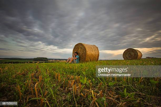 Man making photos in front of hay bale