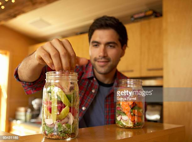 man making pickles in modern kitchen - pickled stock pictures, royalty-free photos & images