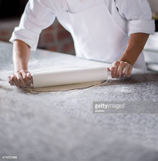 Man making pizza and kneading the dough