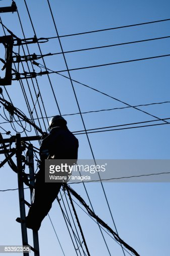 Man Making Repairs To Telephone Lines High-Res Stock Photo ...