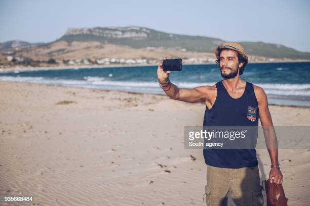 man making selfie at the beach - photo messaging stock pictures, royalty-free photos & images