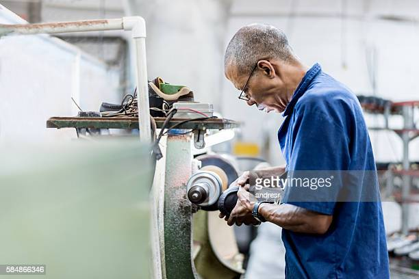 man making shoes at a factory - work shoe stock photos and pictures