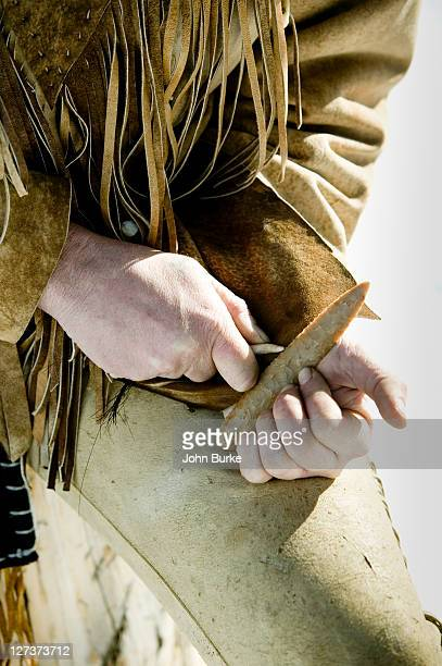 man making stone tools - chert stock photos and pictures