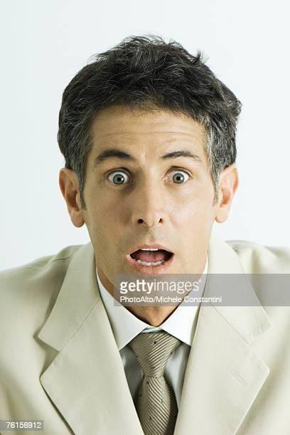 'Man making surprised face, portrait'