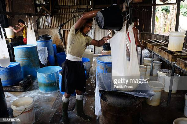 A man making Tahu in a small processing shop Tahu is Indonesian traditional food made from soy It is a healthy food containing vegetable protein...