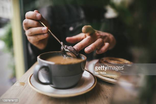man making tea in a cafe close up - restaurant stock pictures, royalty-free photos & images