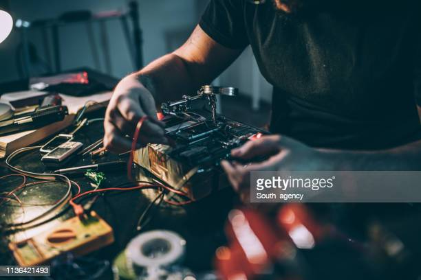 man making time bomb - detonator stock photos and pictures