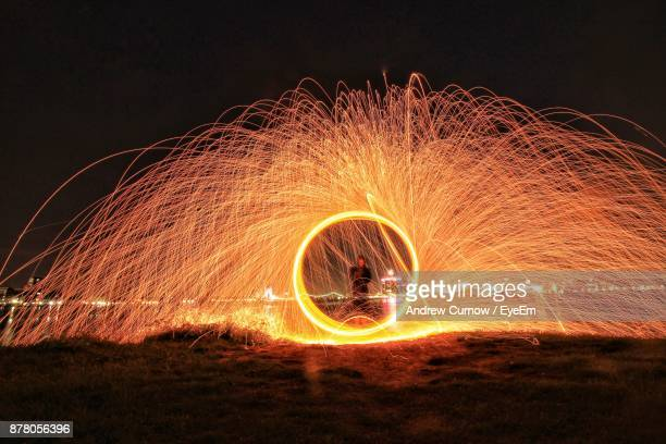 Man Making Wire Wools Against Clear Sky At Night
