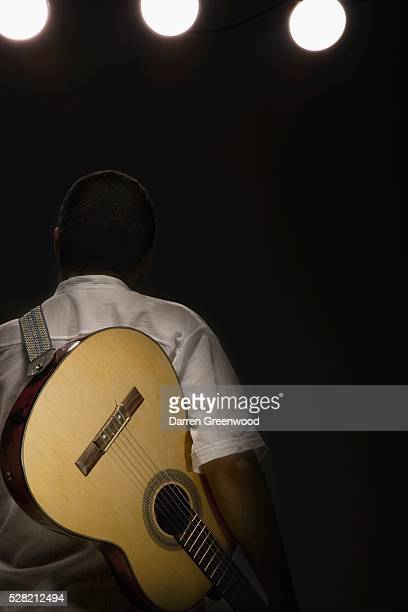 man man with a guitar on a strap - strap stock pictures, royalty-free photos & images