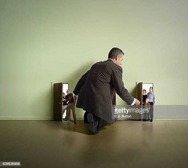 Man managing house guests in doorway