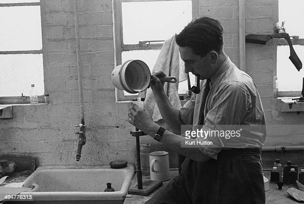 A man manufactiring black market cosmetics in a washroom World War II UK September 1941 Original Publication Picture Post 868 I Take A Look Into A...