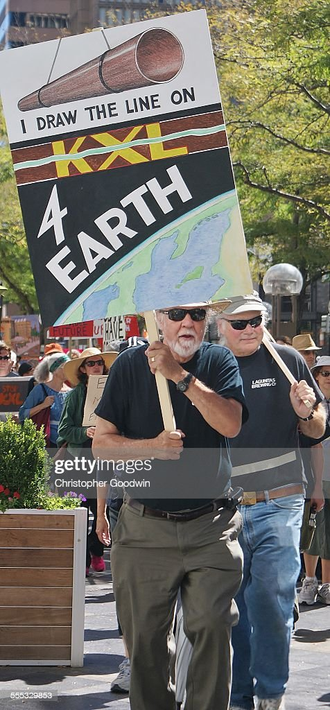 KXL pipeline opponent marching with sign. : News Photo