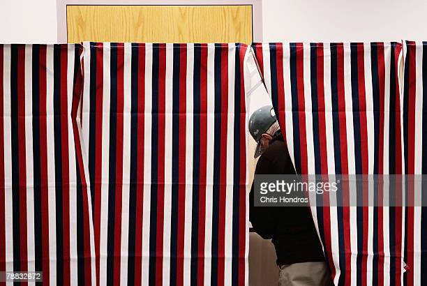 A man marks his ballot in a voting booth January 8 2008 in Manchester New Hampshire Record turnout for the nation's first primary was expected