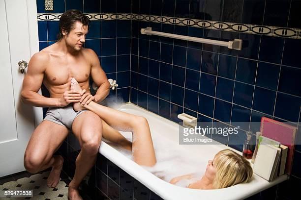 man massaging girlfriend's foot - erotische massage stock-fotos und bilder