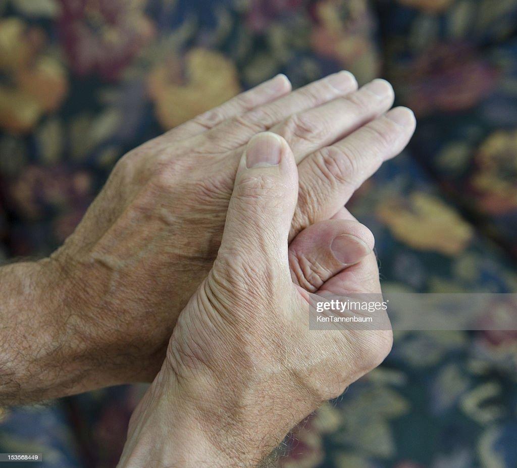 man massaging hands : Stock Photo