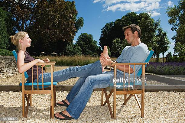 Man massaging his girlfriend's feet