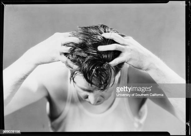 Man massaging scalp Southern California 1932