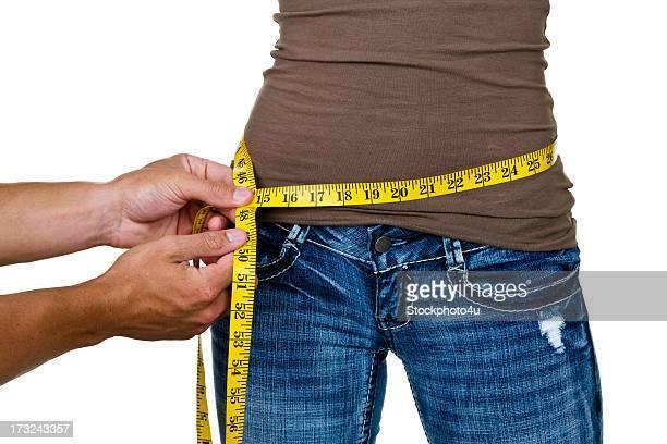 Man measuring a woman's waist