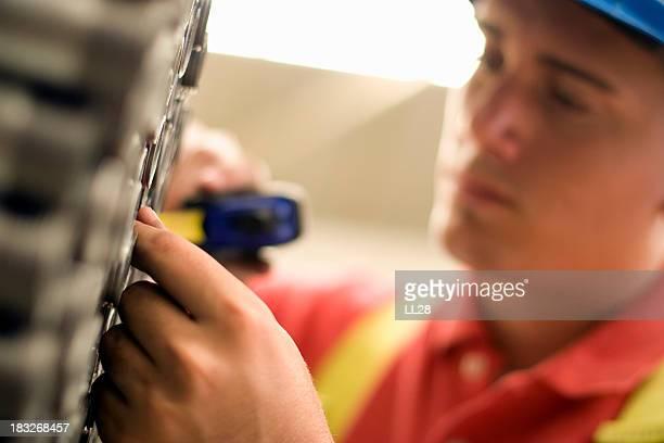 Man Measuring Building Materials
