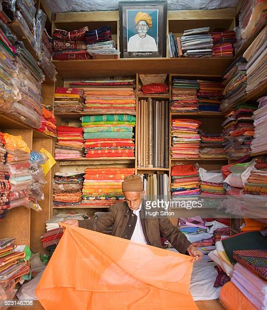 man measuring fabric - hugh sitton india stock pictures, royalty-free photos & images