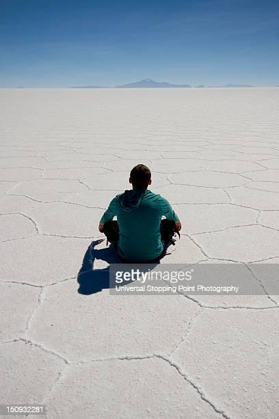 Man meditates on Uyuni salt flat