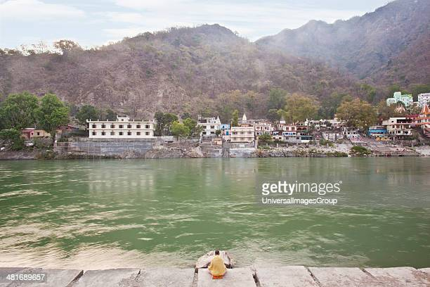 Man meditating at the riverside River Ganges Rishikesh Dehradun District Uttarakhand India