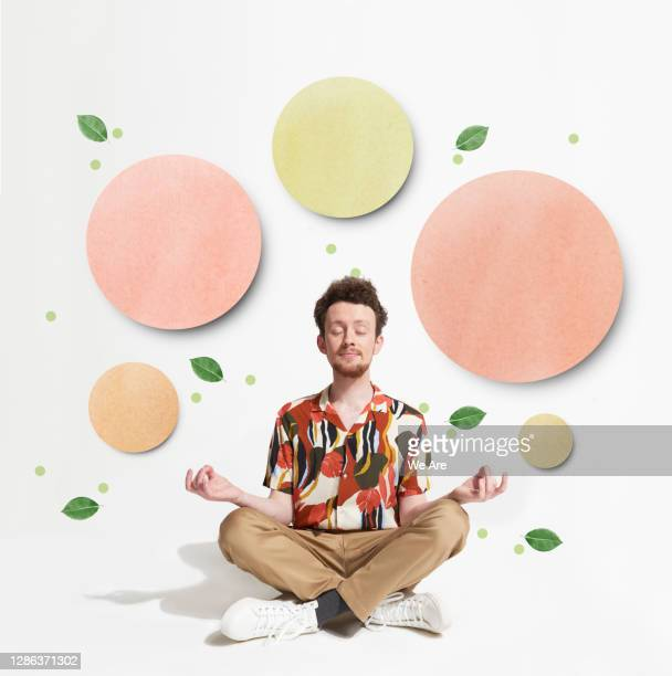 man meditating surrounded by circles - food stock pictures, royalty-free photos & images
