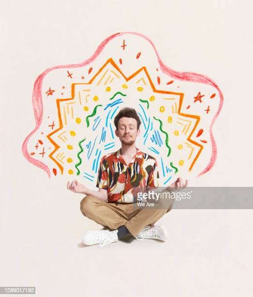 man meditating with drawing - lifestyle stock pictures, royalty-free photos & images