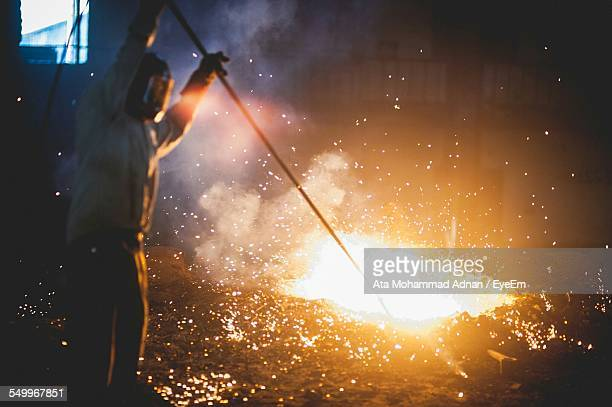 Man Melting Iron At Factory