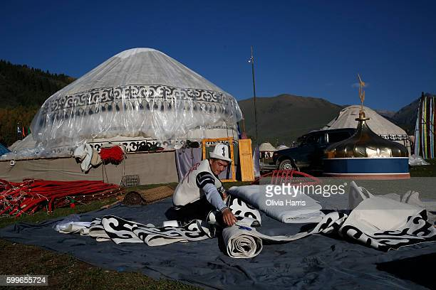 Man mends the decoration for his yurt at the World Nomad Games on September 6, 2016 in Kyrchyn Gorge, Kyrgyzstan. Kyrgyzstan is hosting the second...