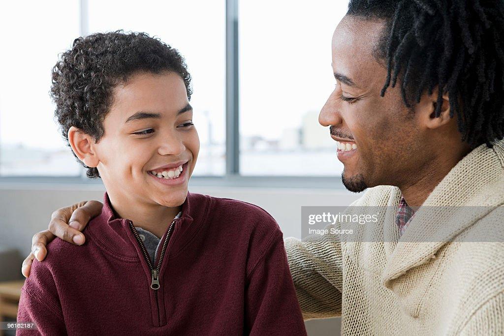 Man mentoring boy : Stock Photo