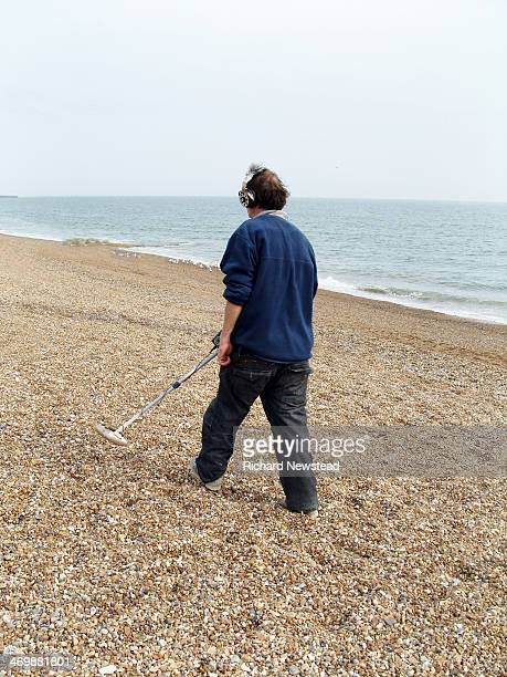 CONTENT] Man metal detecting on Brighton beach Brighton Sussex