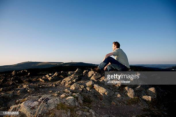 man, mid 40s, looking from herzogenhorn mountain towards feldberg mountain in the black forest, baden-wuerttemberg, germany, europe - vista lateral stock pictures, royalty-free photos & images