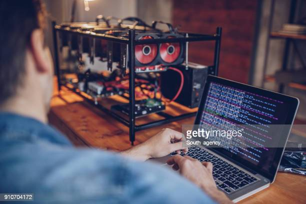 man mining for bitcoin - cryptocurrency mining stock pictures, royalty-free photos & images