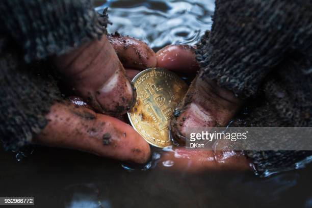 man mining golden bitcoin - bank icon stock photos and pictures