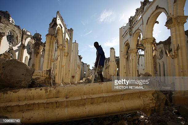 A man missing a leg walks throught the remains of the Notre Dame Cathedral on January 12 2011 in PortauPrince at the one year anniversary of the...