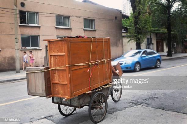 A man mocing furniture on his bike