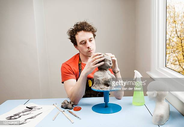 man modelling clay.