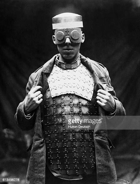 A man models a prototype of armor designed for soldiers to use in battle during World War I UK