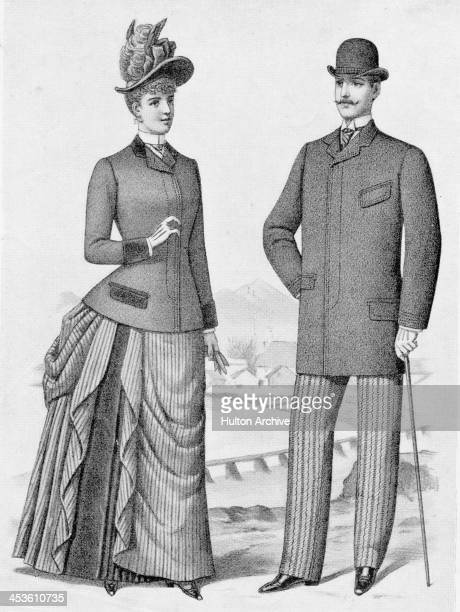 A man models a single breasted overcoat and bowler hat whilst a woman models a coat and feathered hat 1889