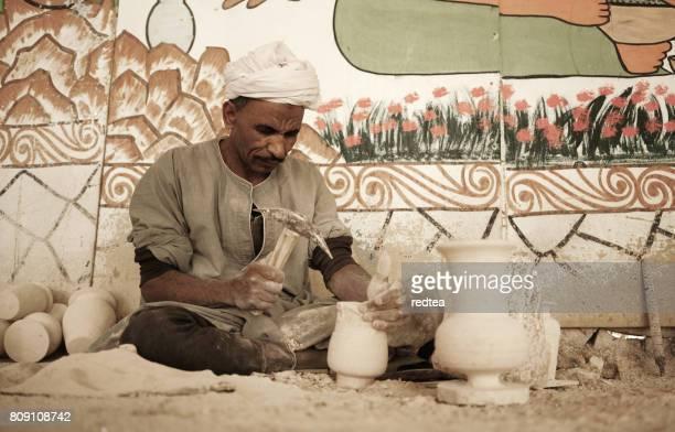 Man Molding the Stone