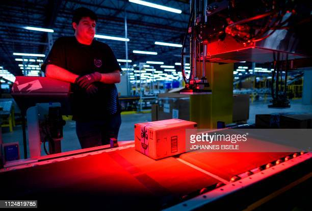 Man monitors the addressing process at the 855,000-square-foot Amazon fulfillment center in Staten Island, one of the five boroughs of New York City,...
