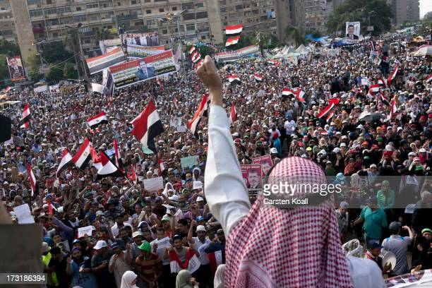 A man motivates proMohamed Morsi supporters at a rally near to where over 50 protesters were purported to have been killed yesterday by members of...