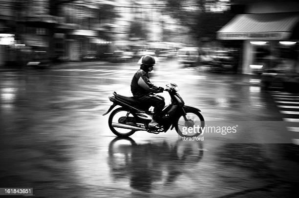 Man Motorcycling In The Rain In Nha Trang, Vietnam