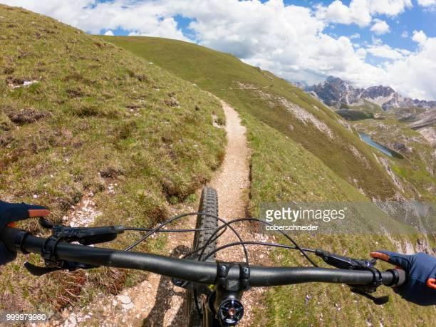 Man mountain biking, Fanes-Sennes-Braies National Park, Dolomites, Trentino, South Tyrol, Italy