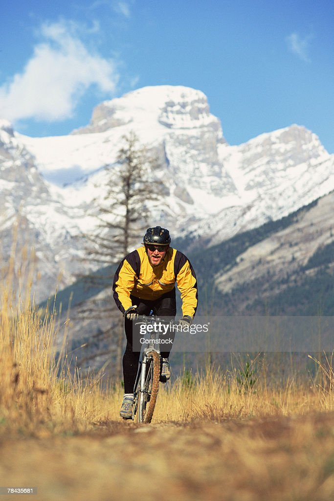 Man mountain biking in British Columbia , Canada : Stock Photo