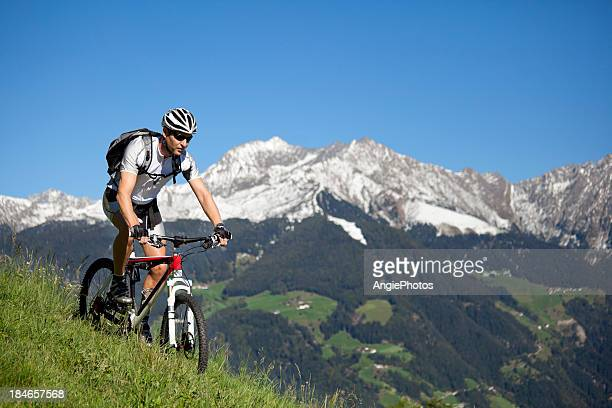 Man mountain biking in the mountains