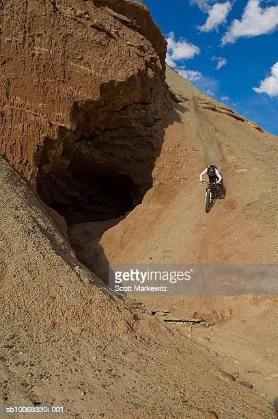man mountain biking on rock formation - fruita colorado stock pictures, royalty-free photos & images