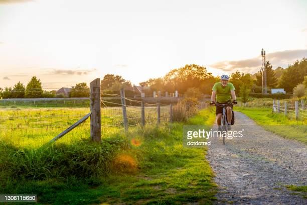 man mountain biking on rural path - surrey england stock pictures, royalty-free photos & images