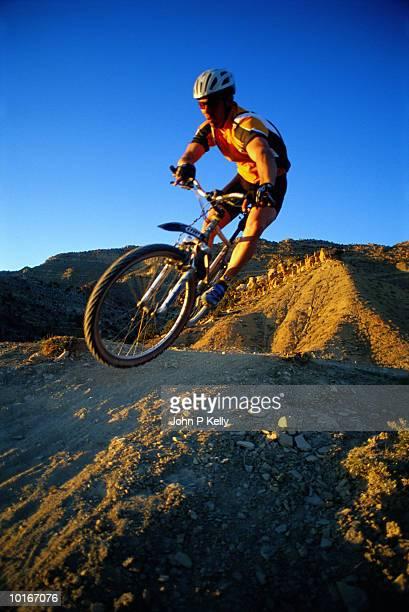 Man mountain biking, Western Colorado, USA